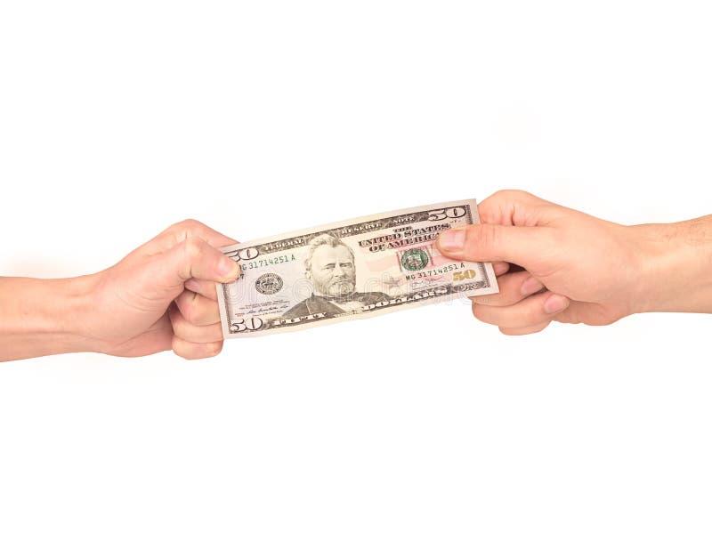 Waluty zażartej rywalizaci pojęcie dla biznesowej rywalizaci Dwa biznesmen walczy nad dolarowym rachunkiem fotografia royalty free