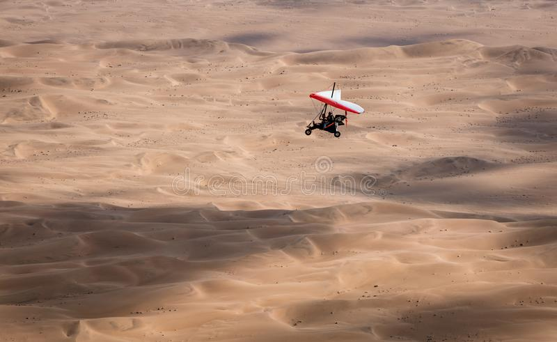 Walvis Bay, Namibia / July 16, 2018: An ultralight aircraft is s stock photos