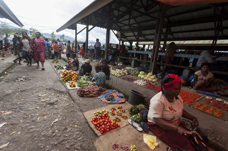 Wamena, Indonesia - January 9, 2010: People are at the local market of Wamena in Baliem Valley, Papua New Guinea.  royalty free stock image