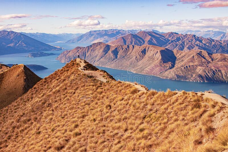 Wanaka lake and the trail leading to the observation point stock images