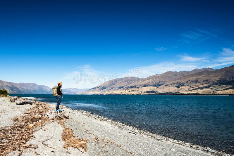 Tourist admires the view while stand next to Lake wanaka Boundary Cree royalty free stock photography