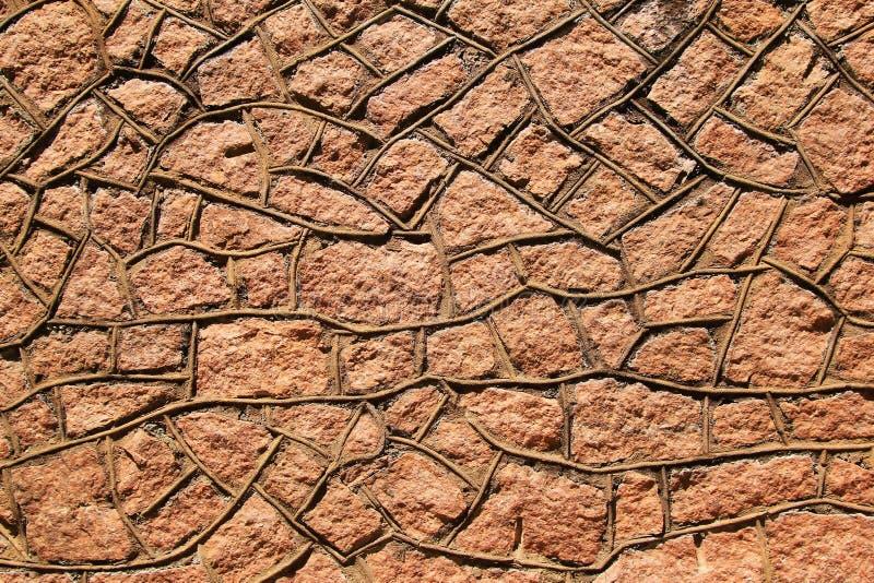 Wand der stein- abstrakter Kunst und der ikonenhaften Stärke stockfoto