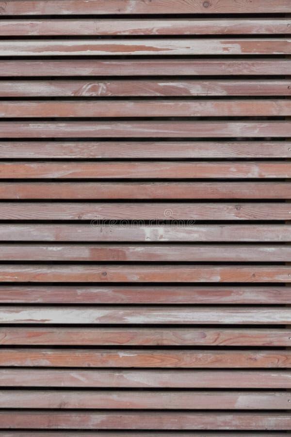Wand hergestellt von den braunen hölzernen Latten lizenzfreie stockbilder