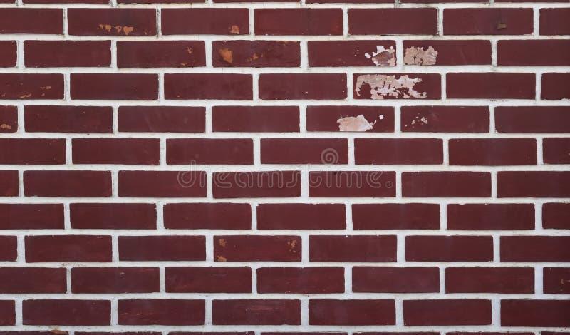 Wand-Hintergrundart-Dekorschmutz des roten Backsteins, Farbe abziehend und schimmelig stockbild