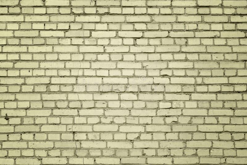 Wand von kleinen gelben Ziegelsteinen Leerer heller Hintergrund stockfoto