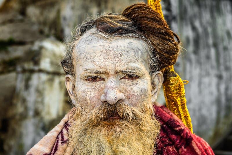 Wandering Shaiva sadhu (holy man) in ancient Pashupatinath Temp stock image