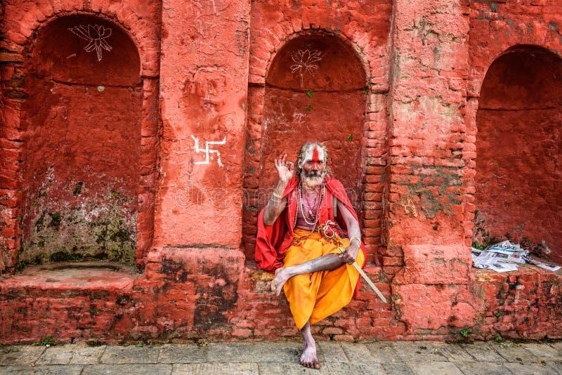 Wandering Shaiva sadhu (holy man) in ancient Pashupatinath Temp. KATHMANDU, NEPAL - OCTOBER 21, 2015 : Wandering Shaiva sadhu (holy man) with traditional face royalty free stock image