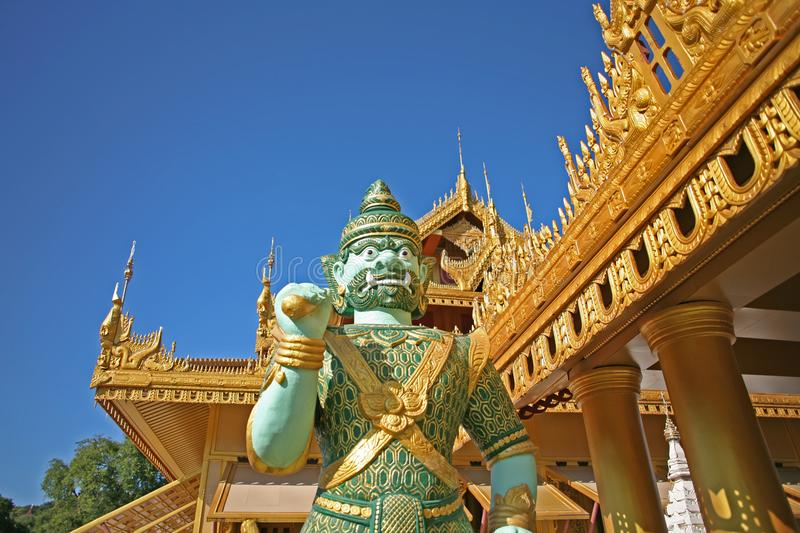 A warrior stands guard in Myanmar Mandalay Pagodas. Wandering the temples and ancient buddhist pagodas of Mandalay, Burma royalty free stock image