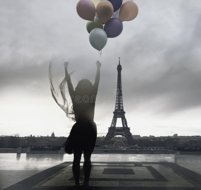 Wanderlust and travel concept. Traveller and tourist woman exploring the world and the city of Paris. Silhouette woman sightseeing stock images