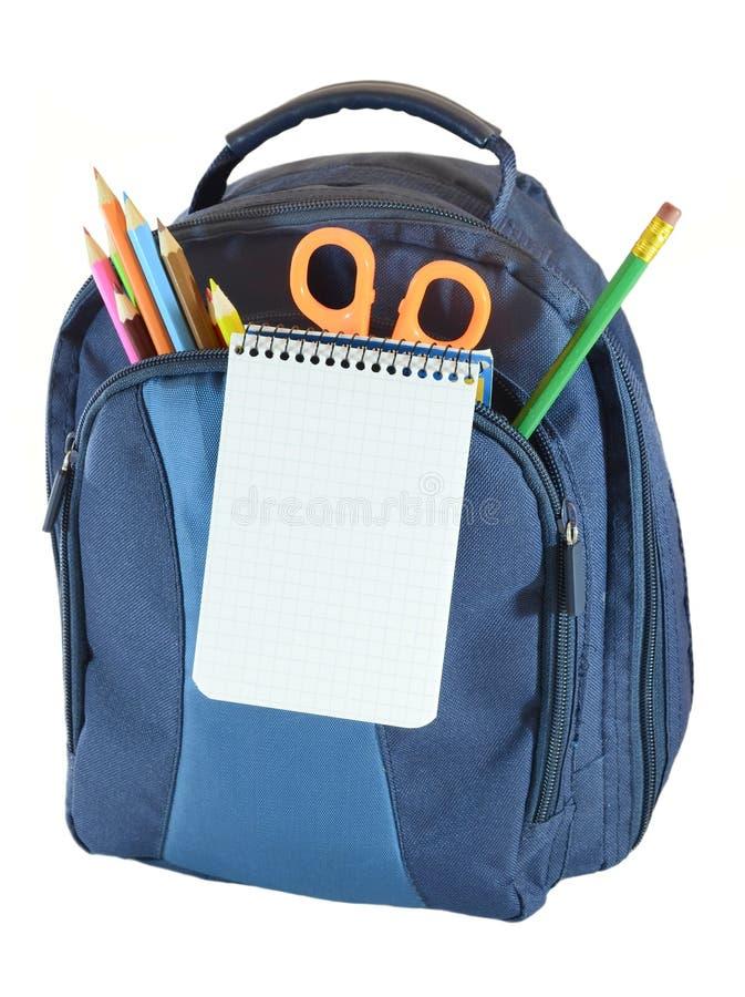 Rucksack mit Schulgegenstand stockfotos