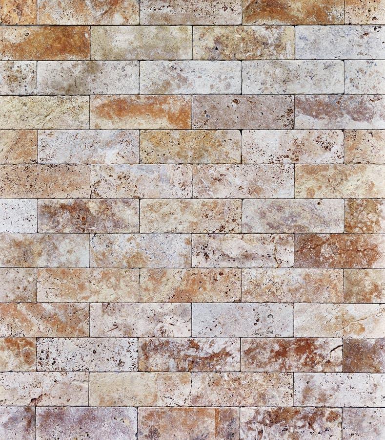 Wandtextuur van travertijnsteen, ondergrond van metselwerk stock fotografie