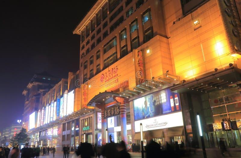 Wangfujing shopping cityscape Beijing China. People visit Dongan Department store in Wangfujing shopping street in Beijing China royalty free stock image