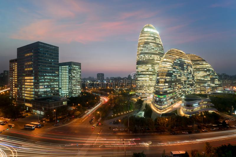 WangJing Soho business district at night in Beijing, China. stock images