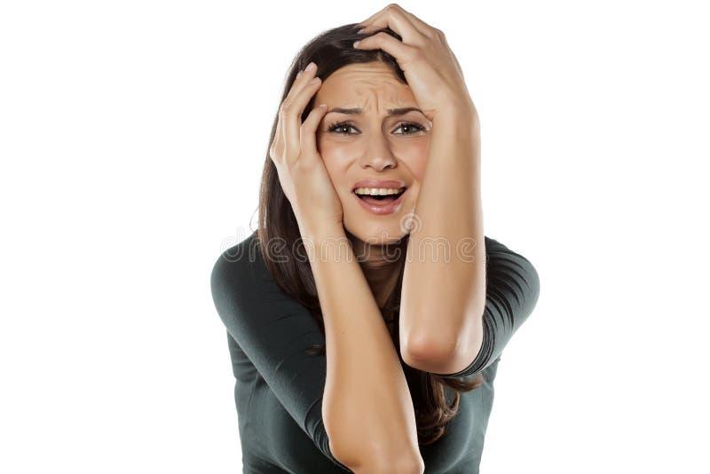 Wanhopige vrouw stock afbeelding