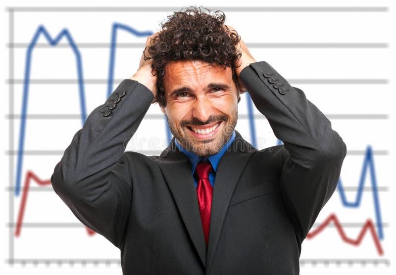 Wanhopige zakenman, financieel crisisconcept stock afbeelding