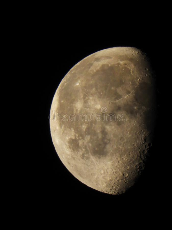 Waning Gibbous Moon Phase at 52% full. The Moon appears to be a circular disk which, at any specific time, is illuminated to some degree by the Sun's stock image