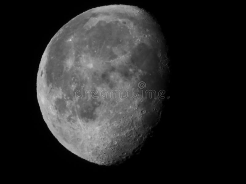 Waning Gibbous Lunar Phase at 86% illumination. The Moon appears to be a circular disk which, at any specific time, is illuminated to some degree by the Sun stock image