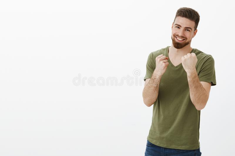 Wanna fight, come and take it. Portrait of excited and playful good-looking happy handsome bearded male with blue eyes royalty free stock images
