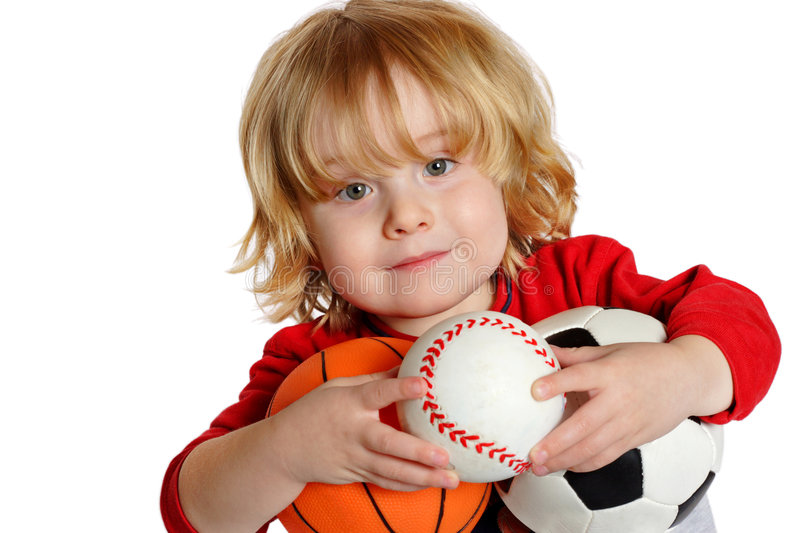 Wanna Play. Closeup of a young boy holding a basketball, baseball, and soccerball