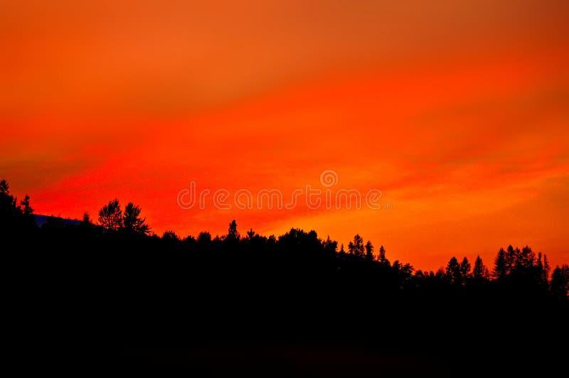 Wanneer de hemel brandt stock afbeelding