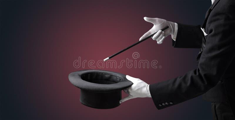 Want's de la mano del ilusionista para conjurar algo fotos de archivo libres de regalías