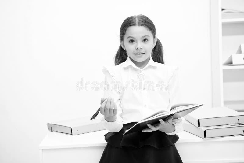 Want to apply new school program. Girl holds pad pen looking for volunteers. Schoolgirl studying include social. Initiatives. Kid school uniform happy face ask stock photos