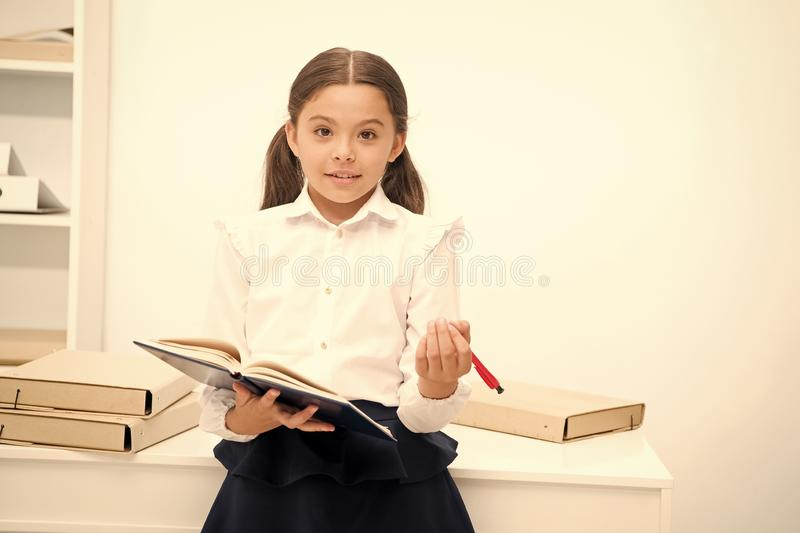 Want to apply new school program. Girl holds pad pen looking for volunteers. Schoolgirl studying include social. Initiatives. Kid school uniform happy face ask royalty free stock photos