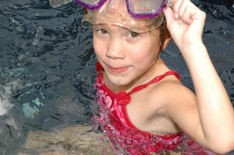 Want to come in?. Little girl lifts up her mask after swimming under water. Pretty, blond model. Going my way royalty free stock photos