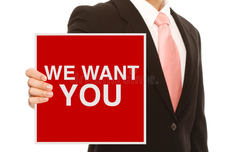 We Want You. A businessman holding a recruitment signboard royalty free stock image