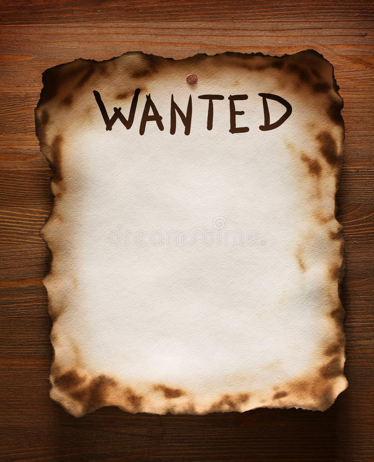 Wanted. The word Wanted is written on an old paper texture on the background of a wooden wall stock photos