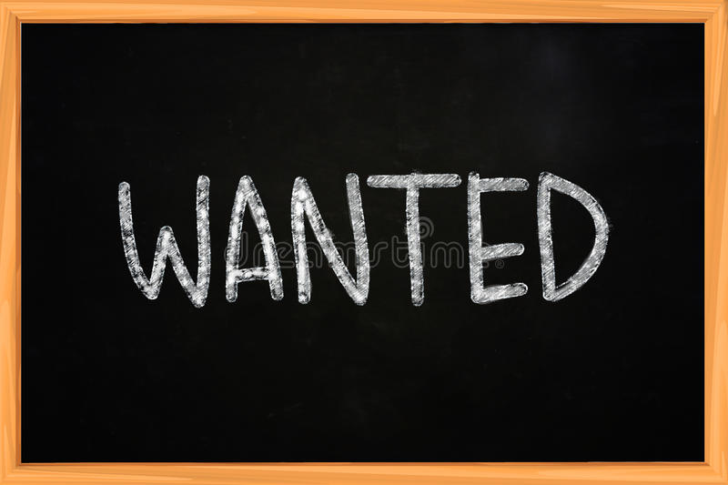 Wanted. Business concept of Wanted word written with chalk on blackboard stock photo