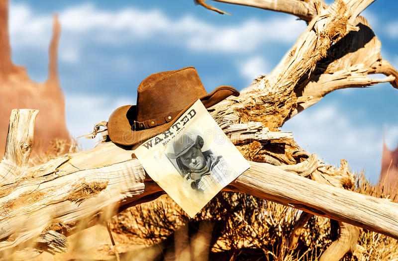 Wanted far west. Vintage wanted poster in a gost town stock photos