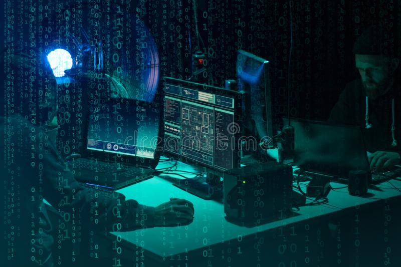 Wanted hackers coding virus ransomware using laptops and computers. Cyber attack, system breaking and malware concept. royalty free stock photos