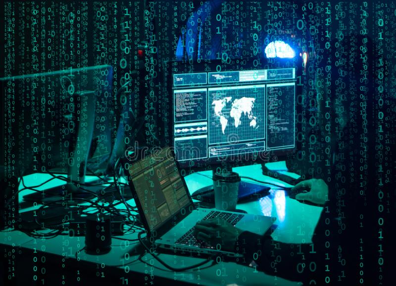 Wanted hackers coding virus ransomware using laptops and computers. Cyber attack, system breaking and malware concept. royalty free stock image