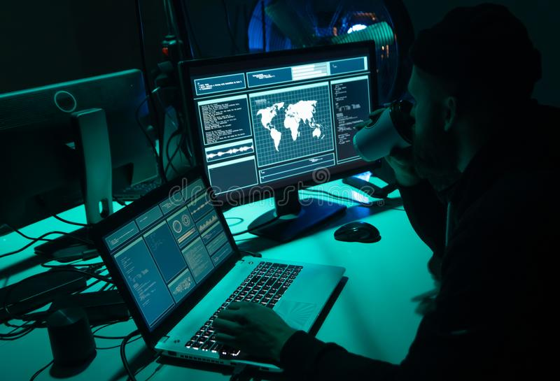 Wanted hackers coding virus ransomware using laptops and computers. Cyber attack, system breaking and malware concept. royalty free stock images