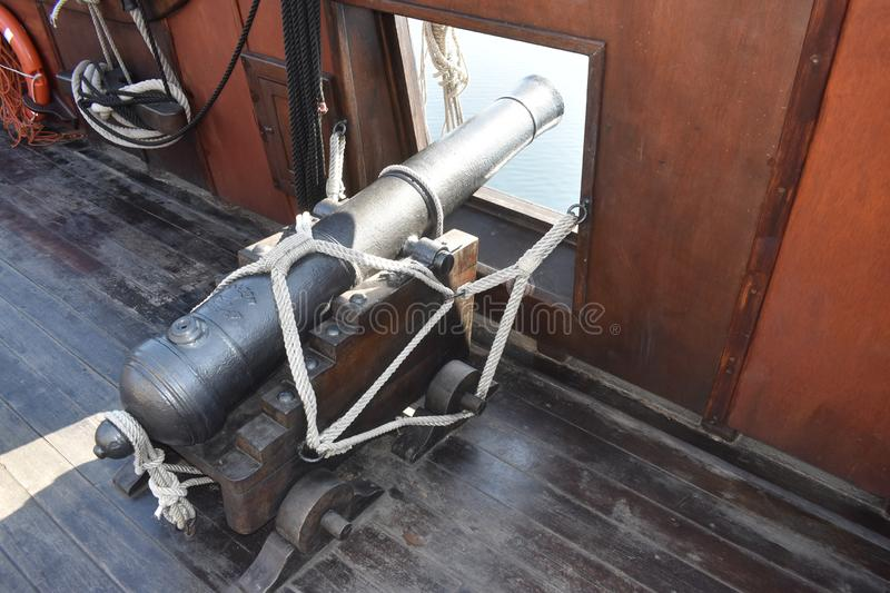 A war cannon weapon on the deck of a boat stock images