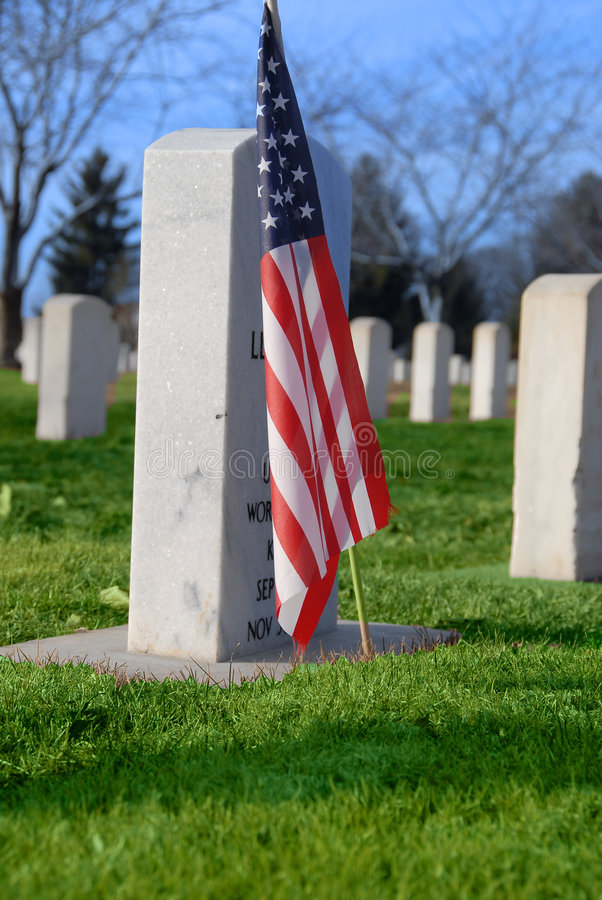 War cemetery. American flag in cemetery for war vets stock photos