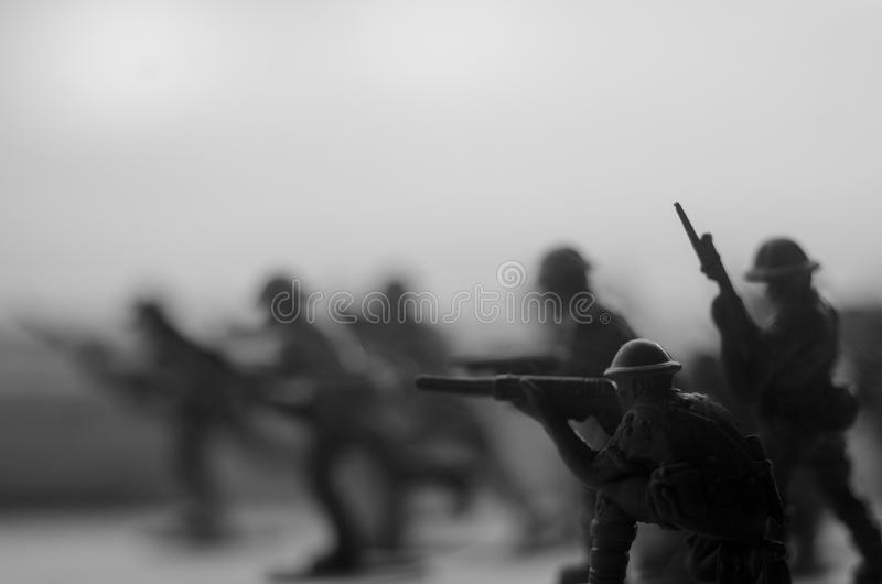 War Concept. Military silhouettes fighting scene on war fog sky background, World War Soldiers Silhouettes Below Cloudy Skyline At royalty free stock image