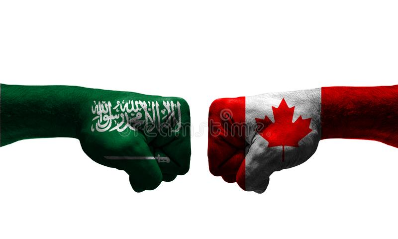 The War between 2 Countries. The unfair War between Saudi Arabia and Canada countries / closed fist stock images