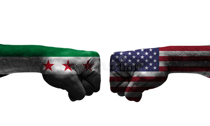 The War between 2 Countries. The unfair War between Syria and USA countries / closed fist royalty free stock images