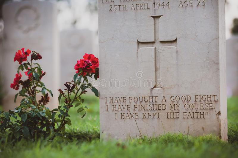 War hero. War memorial tombstone with epitaph. Commonwealth Cemetery of Cassino in Italy of the Second World War. War memorial tombstone with epitaph royalty free stock image