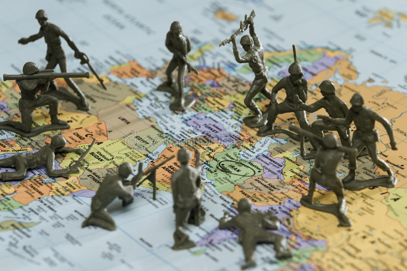 War on Iran. Concept image using a wold map and toy soldiers to represent a war on Iran stock photography