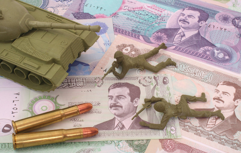 War in Iraq. Currency From Iraq with Bullets and Plastic Soldiers stock photos
