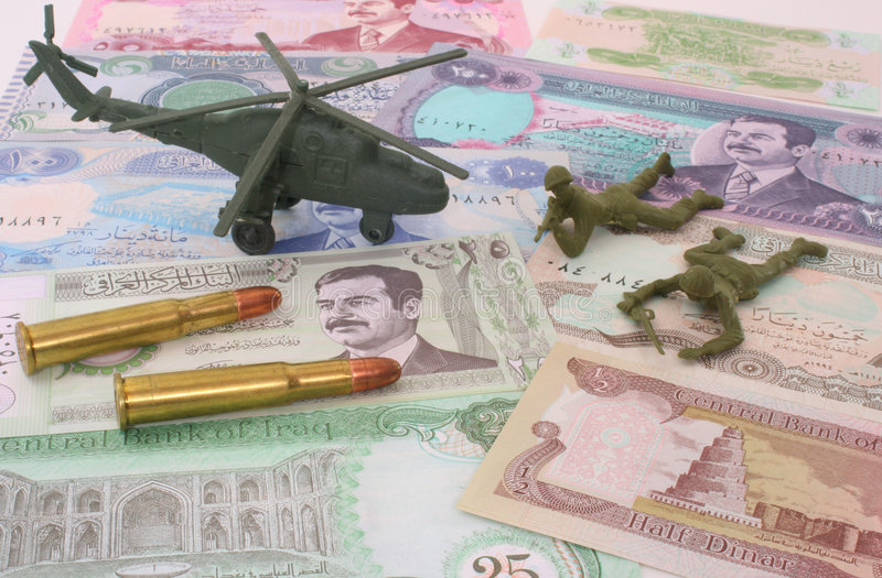 War in Iraq. Currency From Iraq with Bullets and Plastic Soldiers stock photography