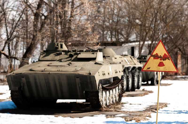 War machines with radioactivity sign at Chernobyl. In the winter stock images