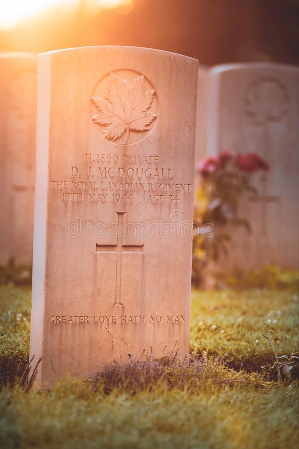 War memorial Canadian tombstone with epitaph. Cassino / Italy - August 17, 2019: War memorial Canadian tombstone with epitaph. Commonwealth Cemetery of Cassino royalty free stock image