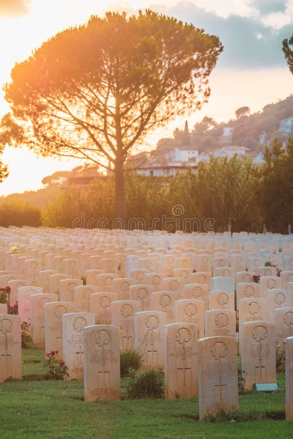 War memorial Canadian tombstones in Cassino, Italy. Cassino / Italy - August 17, 2019: War memorial Canadian tombstone with epitaph. Commonwealth Cemetery of royalty free stock image