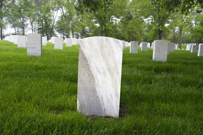 War Memorial Cemetery with Blank Tombstone Grave Marker. War memorial cemetery or graveyard with a blank tombstone grave marker stock photo