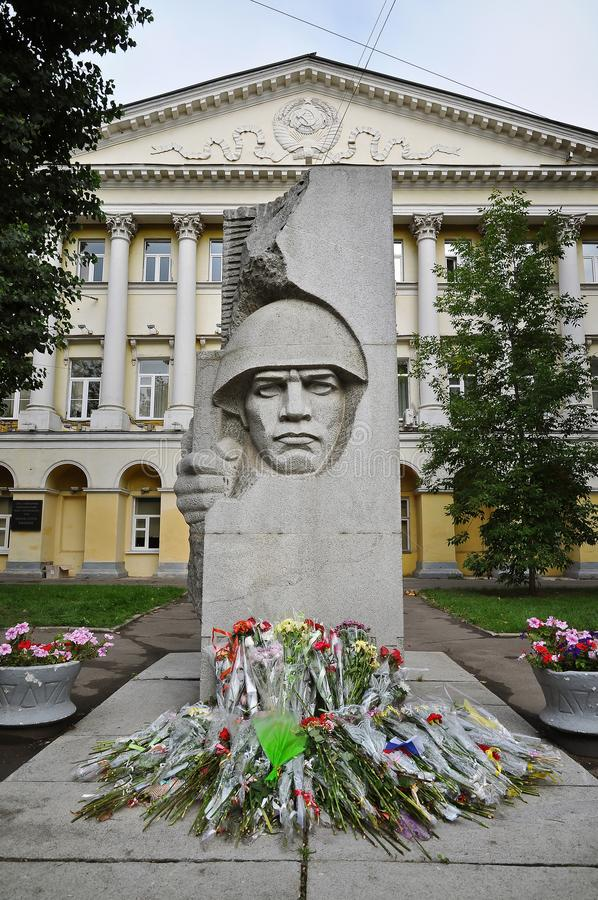 War memorial and flowers outside the Moscow State Linguistic University royalty free stock image