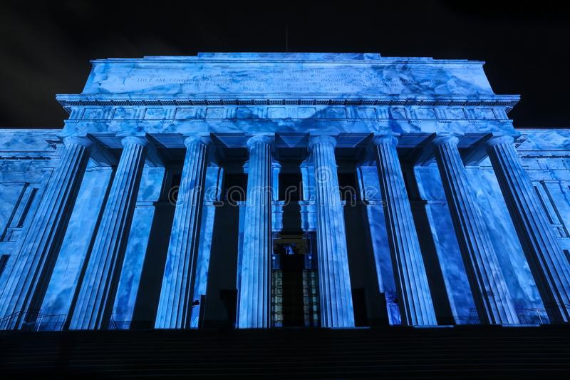 The War Memorial Museum, Auckland, NZ, lit up a vivid blue royalty free stock photo